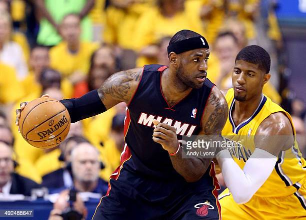 LeBron James of the Miami Heat controls the ball against Paul George of the Indiana Pacers during Game Two of the Eastern Conference Finals of the...