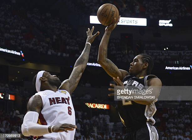 LeBron James of the Miami Heat defends against Kawhi Leonard of the San Antonio Spurs during the third quarter of Game 7 of the NBA Finals at the...