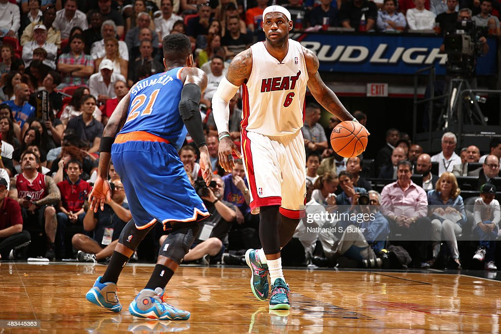 LeBron James #6 of the Miami Heat dribbles the ball during the game against Iman Shumpert #21 of the New York Knicks on April 6, 2014 at American Airlines Arena in Miami, Florida.