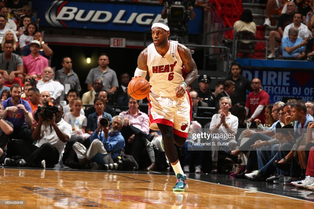 LeBron James #6 of the Miami Heat dribbles the ball during the game against the New York Knicks on April 6, 2014 at American Airlines Arena in Miami, Florida.