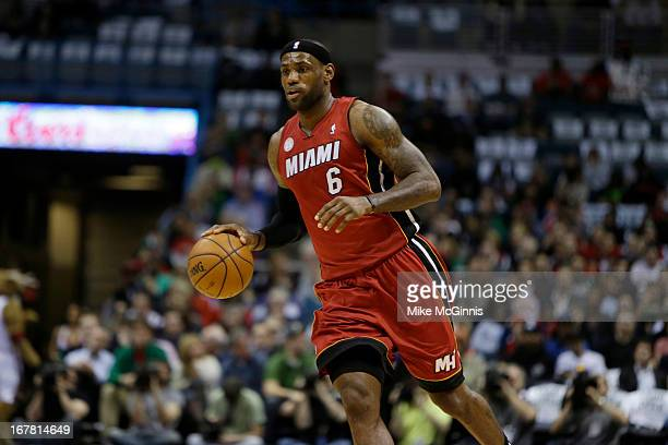 LeBron James of the Miami Heat dribbles up the court against the Milwaukee Bucks during Game Three of the Western Conference Quarterfinals of the...