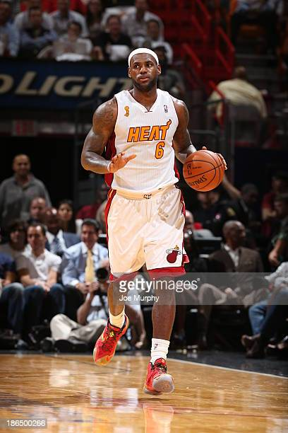 LeBron James of the Miami Heat dribbles up the floor against the Chicago Bulls on October 29 2013 at American Airlines Arena in Miami Florida NOTE TO...
