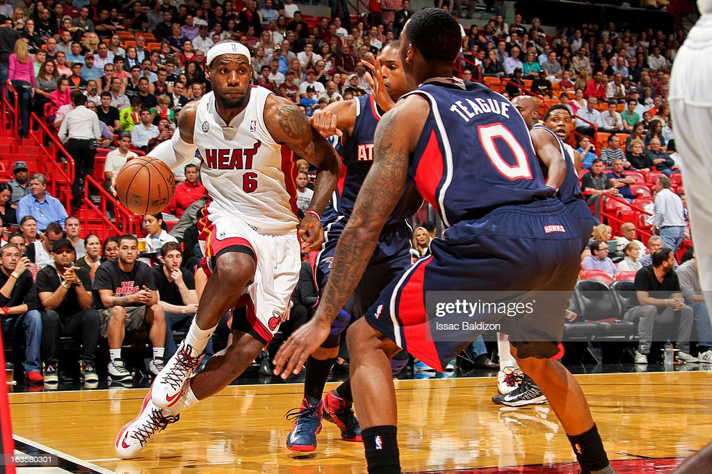 LeBron James #6 of the Miami Heat drives against Jeff Teague #0 of the Atlanta Hawks on March 12, 2013 at American Airlines Arena in Miami, Florida.