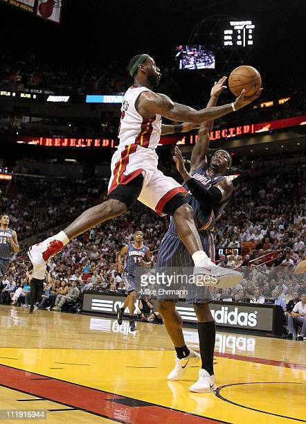 LeBron James of the Miami Heat drives against Kwame Brown of the Charlotte Bobcats during a game at American Airlines Arena on April 8 2011 in Miami...