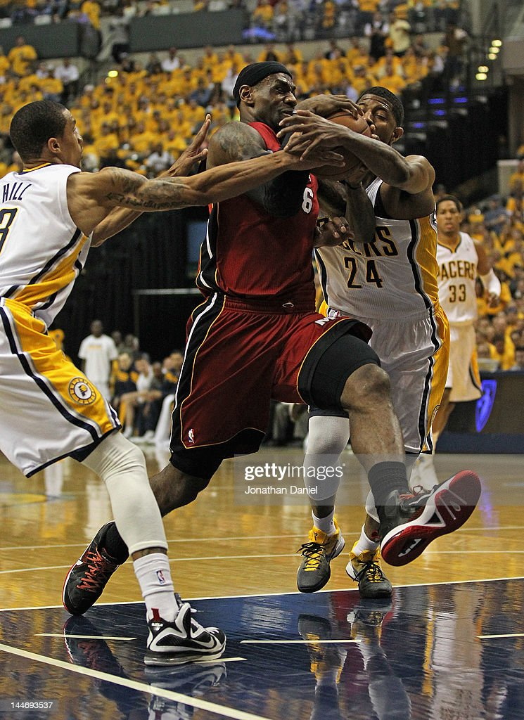 LeBron James #6 of the Miami Heat drives between George Hill #3 and Paul George #24 of the Indiana Pacers in Game Three of the Eastern Conference Semifinals in the 2012 NBA Playoffs at Bankers Life Fieldhouse on May 17, 2012 in Indianapolis, Indiana.