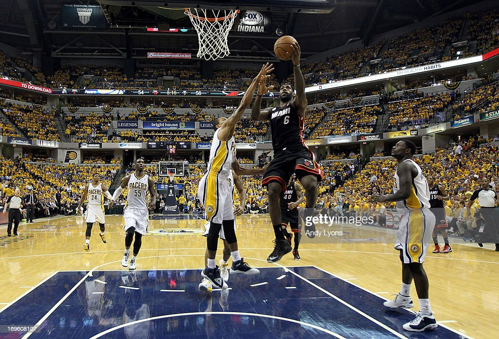 LeBron James #6 of the Miami Heat drives for a shot attempt in the second half against George Hill #3 of the Indiana Pacers during Game Four of the Eastern Conference Finals of the 2013 NBA Playoffs at Bankers Life Fieldhouse on May 28, 2013 in Indianapolis, Indiana.
