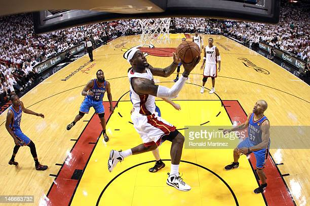 LeBron James of the Miami Heat drives for a shot attemptm in the second half against Derek Fisher of the Oklahoma City Thunder in Game Five of the...