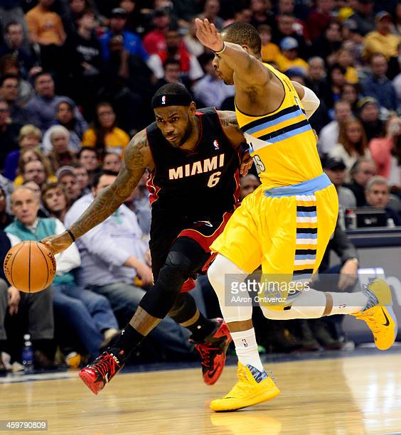 LeBron James of the Miami Heat drives on Randy Foye of the Denver Nuggets during the second half of Miami's 9794 win The Denver Nuggets hosted the...