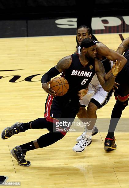 LeBron James of the Miami Heat drives to the basket against Kawhi Leonard of the San Antonio Spurs during Game Five of the 2014 NBA Finals at the ATT...