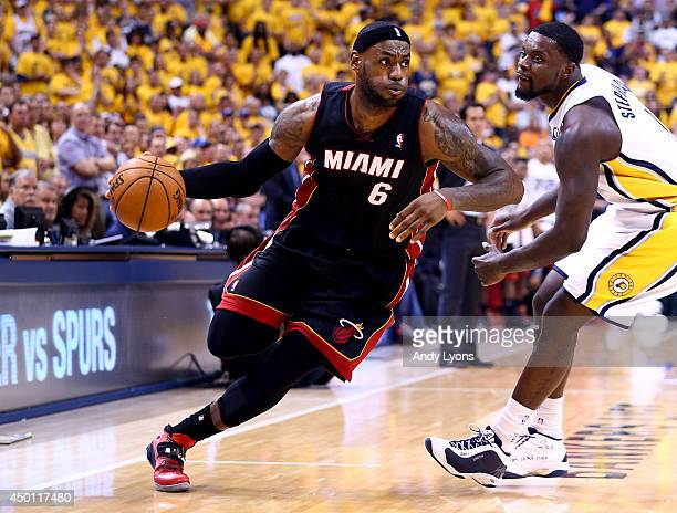 LeBron James of the Miami Heat drives to the basket against Lance Stephenson of the Indiana Pacers during Game Five of the Eastern Conference Finals...