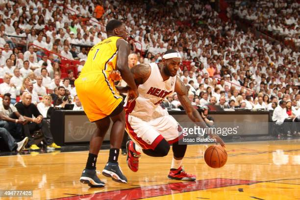 LeBron James of the Miami Heat drives to the basket against Lance Stephenson of the Indiana Pacers in Game Six of the Eastern Conference Finals...