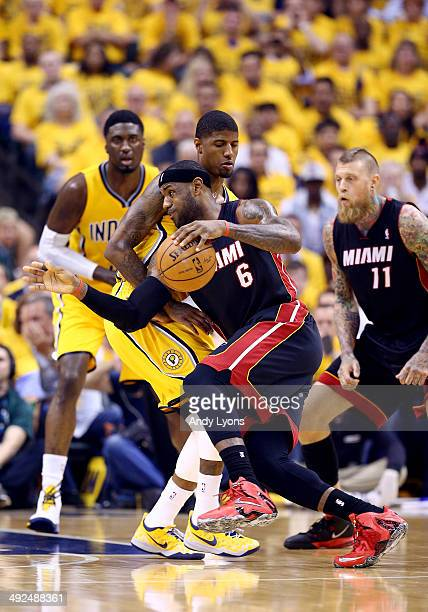LeBron James of the Miami Heat drives to the basket against Paul George of the Indiana Pacers during Game Two of the Eastern Conference Finals of the...