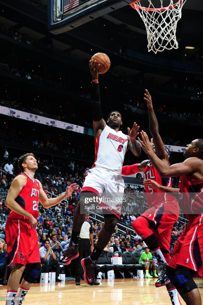 LeBron James #6 of the Miami Heat drives to the basket against the Atlanta Hawks at Philips Arena on November 9, 2012 in Atlanta, Georgia.