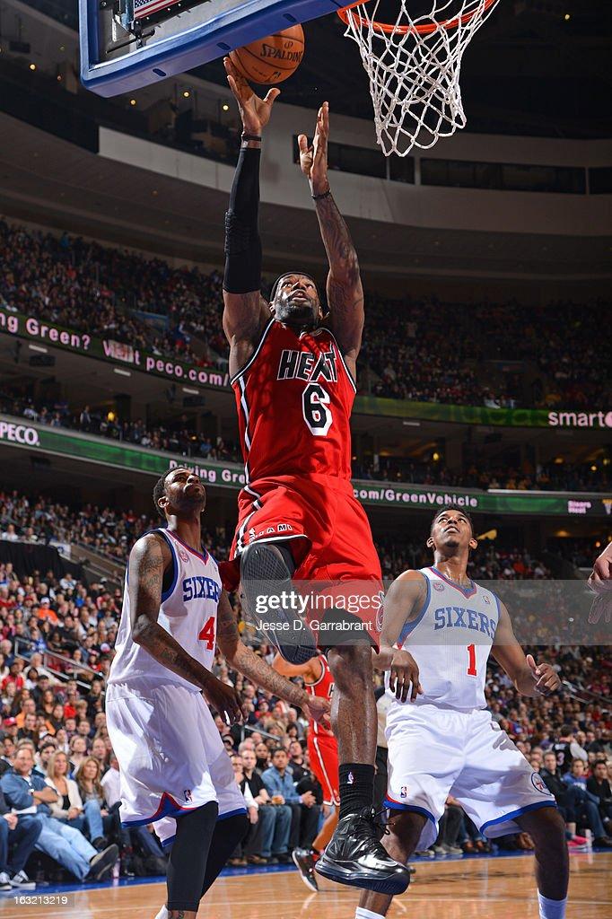 LeBron James #6 of the Miami Heat drives to the basket against the Philadelphia 76ers at the Wells Fargo Center on February 23, 2013 in Philadelphia, Pennsylvania.
