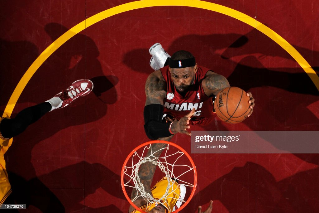 LeBron James #6 of the Miami Heat drives to the basket against the Cleveland Cavaliers at The Quicken Loans Arena on March 20, 2013 in Cleveland, Ohio.
