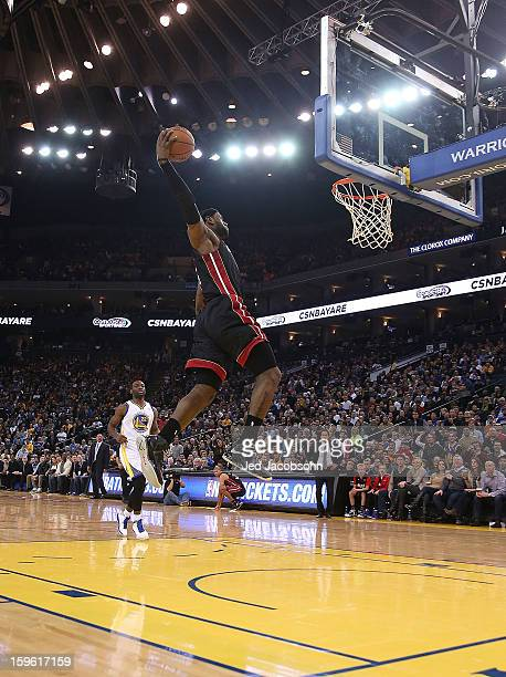 LeBron James of the Miami Heat drives to the basket against the Golden State Warriors on January 16 2013 at Oracle Arena in Oakland California NOTE...