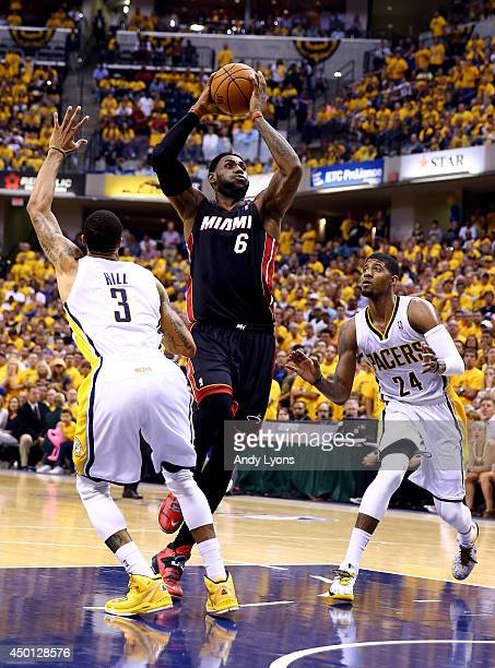 LeBron James of the Miami Heat drives to the basket as George Hill of the Indiana Pacers defends during Game Five of the Eastern Conference Finals of...
