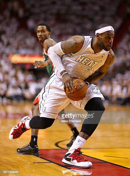 LeBron James of the Miami Heat drives to the basket during Game 1 of the Eastern Conference Quarterfinals of the 2013 NBA Playoffs at against the...