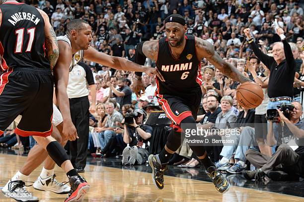 LeBron James of the Miami Heat drives to the basket during Game Five of the 2014 NBA Finals between the Miami Heat and San Antonio Spurs at ATT...