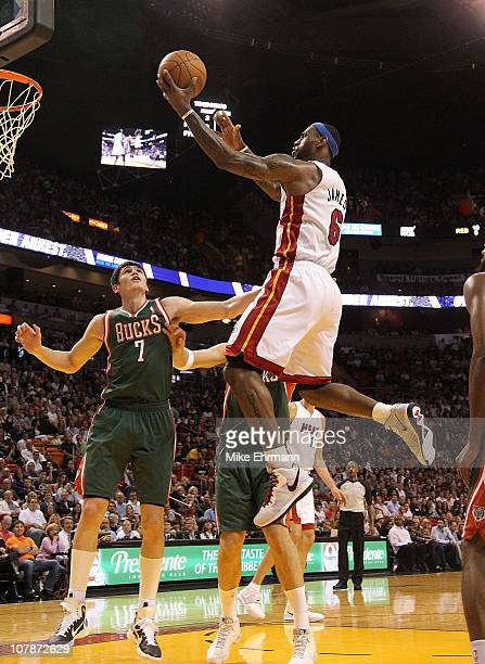 LeBron James of the Miami Heat drives to the rim over Ersan Ilyasova of the Milwaukee Bucks during a game at American Airlines Arena on January 4...