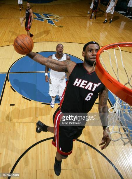LeBron James of the Miami Heat dunks against Andray Blatche of the Washington Wizards at the Verizon Center on December 18 2010 in Washington DC NOTE...