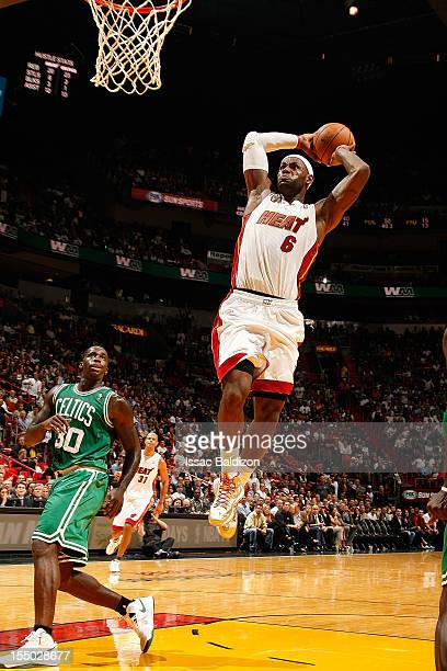 LeBron James of the Miami Heat dunks against Brandon Bass of the Boston Celtics during the NBA game on October 30 2012 at American Airlines Arena in...