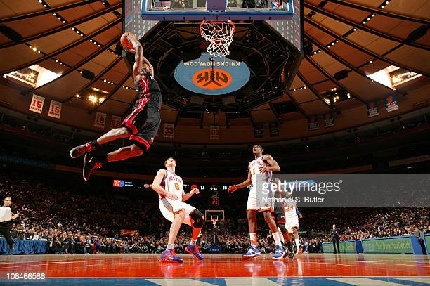 LeBron James of the Miami Heat dunks against Danilo Gallinari of the New York Knicks during a game on January 27 2011 at Madison Square Garden in New...