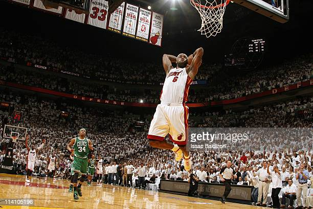 LeBron James of the Miami Heat dunks against Paul Pierce of the Boston Celtics in Game Five of the Eastern Conference Semifinals in the 2011 NBA...
