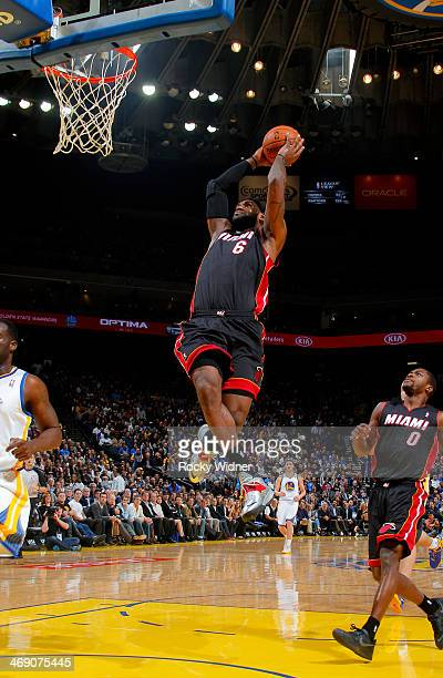 LeBron James of the Miami Heat dunks against the Golden State Warriors on February 12 2014 at Oracle Arena in Oakland California NOTE TO USER User...