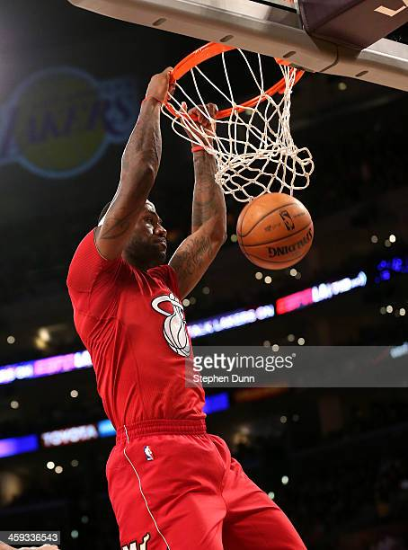 LeBron James of the Miami Heat dunks against the Los Angeles Lakers at Staples Center on December 25 2013 in Los Angeles California The Heat won...