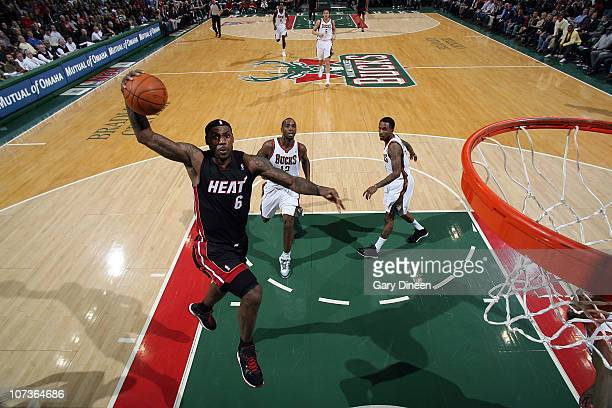 LeBron James of the Miami Heat dunks against the Milwaukee Bucks during the NBA game on December 6 2010 at the Bradley Center in Milwaukee Wisconsin...