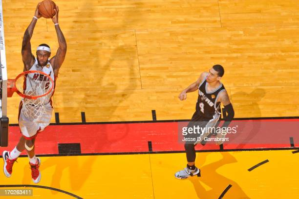 LeBron James of the Miami Heat dunks ahead of Danny Green of the San Antonio Spurs during Game Two of the 2013 NBA Finals on June 9 2013 at American...