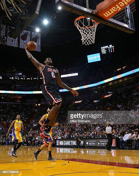 LeBron James of the Miami Heat dunks during a game against the Los Angeles Lakers at American Airlines Arena on January 23 2014 in Miami Florida NOTE...