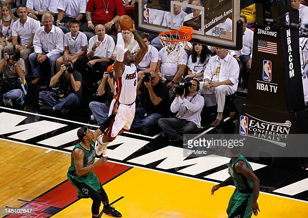 LeBron James of the Miami Heat dunks in the first quarter against Paul Pierce of the Boston Celtics in Game One of the Eastern Conference Finals in...
