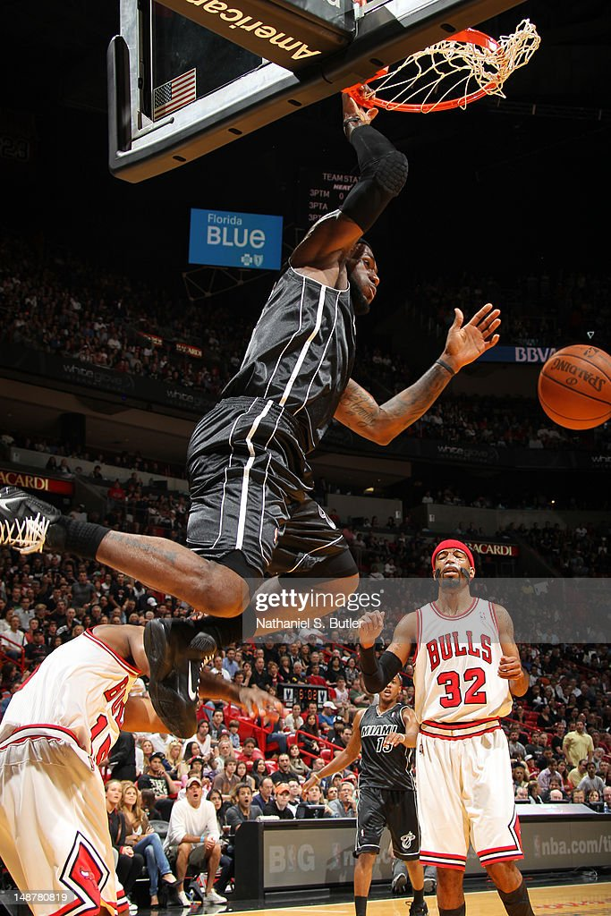 LeBron James #6 of the Miami Heat dunks over John Lucas III #15 of the Chicago Bulls on January 29, 2012 at the American Airlines Arena in Miami, Florida.
