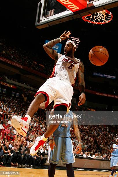 LeBron James of the Miami Heat dunks over Wilson Chandler of the Denver Nuggets on March 19 2011 at American Airlines Arena in Miami Florida NOTE TO...