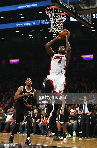 LeBron James of the Miami Heat dunks the ball against the Brooklyn Nets during their game at the Barclays Center on November 1 2013 in the Brooklyn...