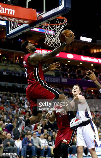 LeBron James of the Miami Heat dunks the ball during their game against the Charlotte Bobcats at Time Warner Cable Arena on January 18 2014 in...