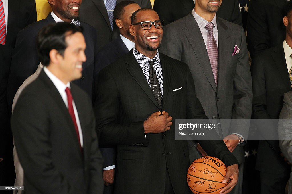 LeBron James #6 of the Miami Heat enjoys a joke during a visit by the Miami Heat to the White House to commemorate the 2012 NBA Champions on January 28, 2013 in Washington, DC.