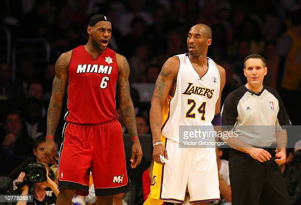 LeBron James of the Miami Heat exchanges words with Kobe Bryant of the Los Angeles Lakers late in the fourth quarter during the NBA game at Staples...