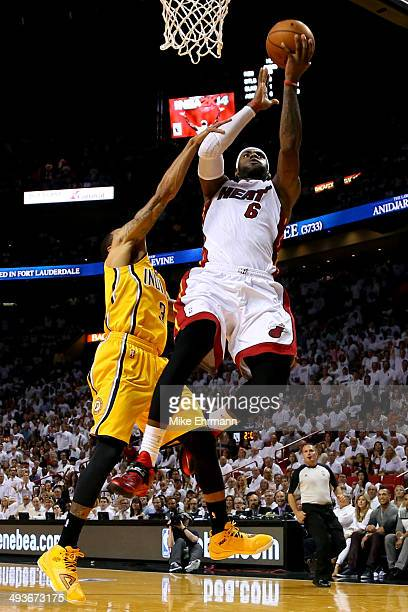 LeBron James of the Miami Heat gets fouled in the second period by George Hill of the Indiana Pacers during Game Three of the Eastern Conference...