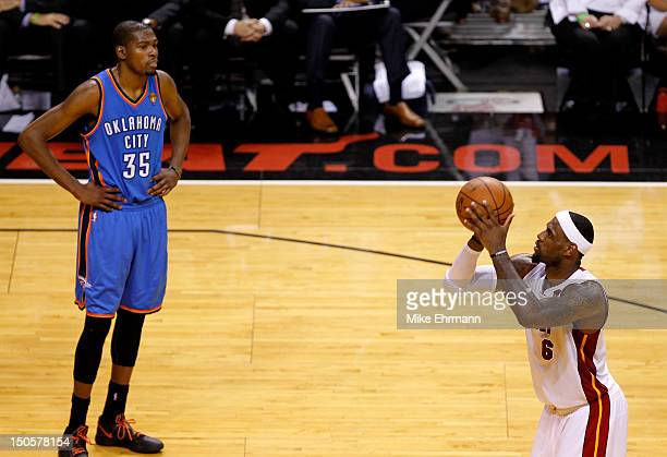 LeBron James of the Miami Heat gets set to shoot a free throw as Kevin Durant of the Oklahoma City Thunder looks on in Game Five of the 2012 NBA...
