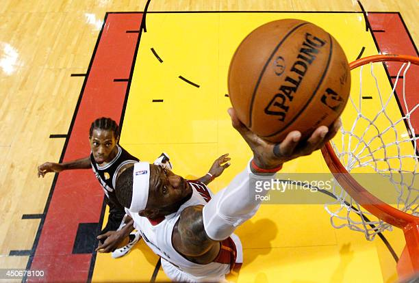 LeBron James of the Miami Heat goes to the basket against Kawhi Leonard of the San Antonio Spurs during Game Three of the 2014 NBA Finals at American...