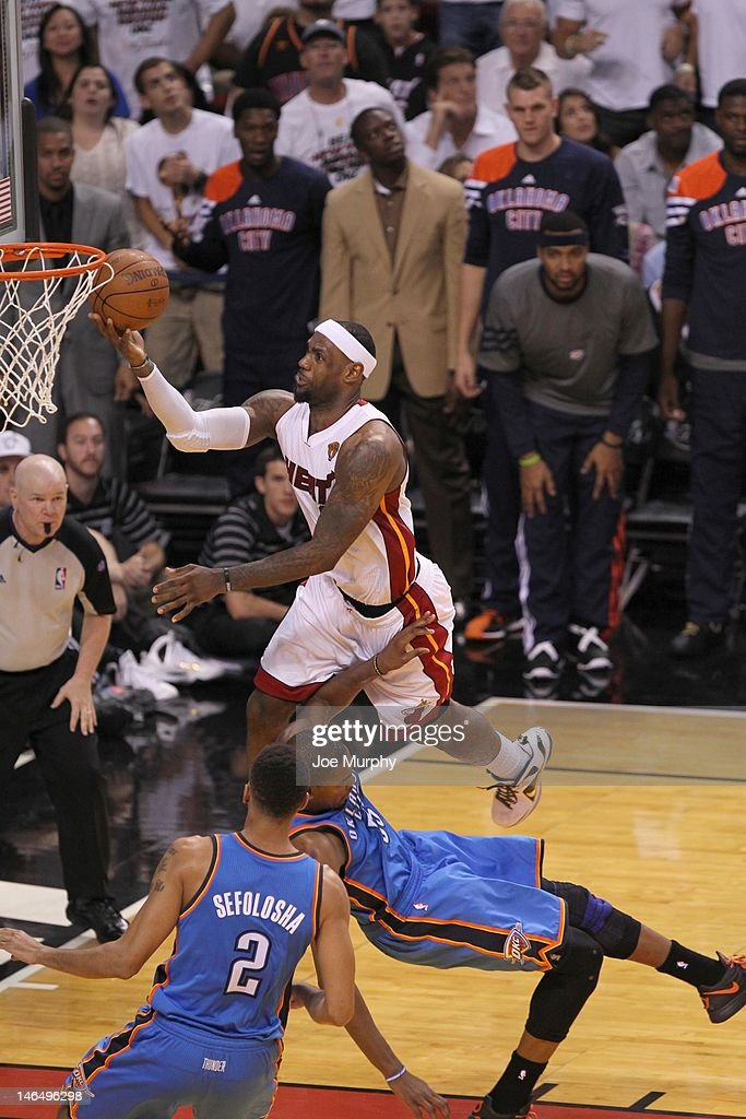 LeBron James #6 of the Miami Heat goes to the basket against Kevin Durant #35 of the Oklahoma City Thunder during Game Three of the 2012 NBA Finals between the Miami Heat and the Oklahoma City Thunder at American Airlines Arena on June 17, 2012 in Miami, Florida.