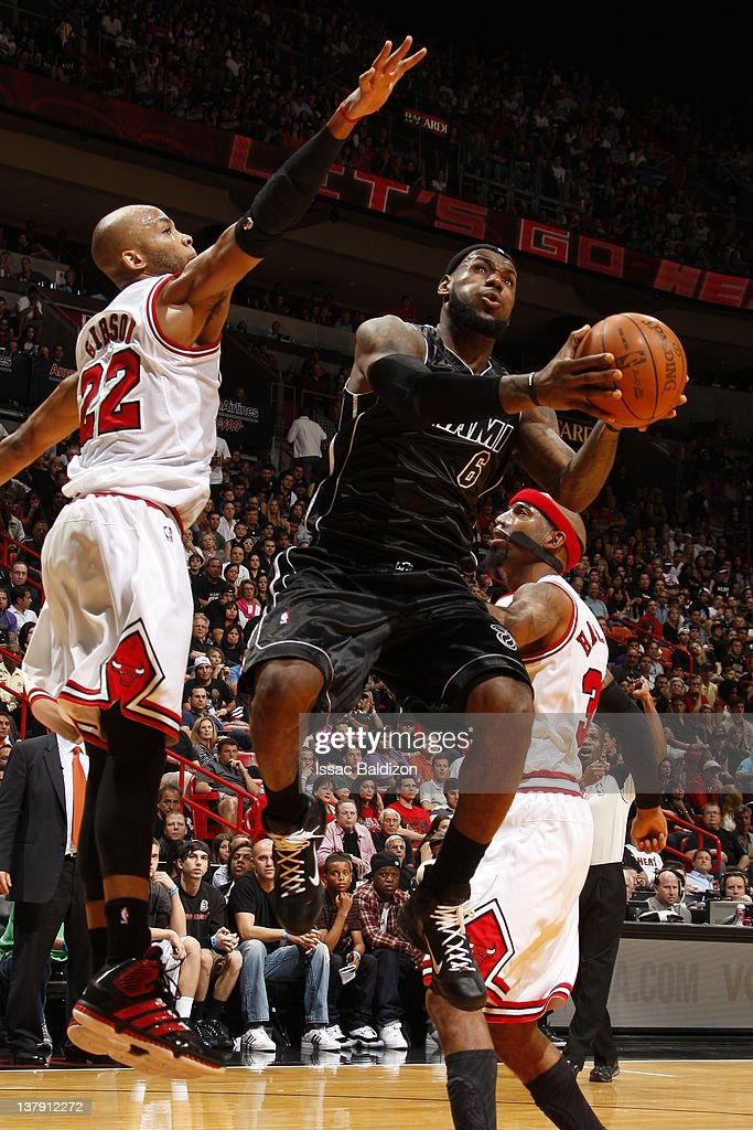 LeBron James #6 of the Miami Heat goes to the basket against Taj Gibson #22 of the Chicago Bulls during the game on January 29, 2012 at American Airlines Arena in Miami, Florida.