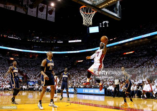 LeBron James of the Miami Heat goes to the basket against the Indiana Pacers during Game Four of the Eastern Conference Finals of the 2014 NBA...