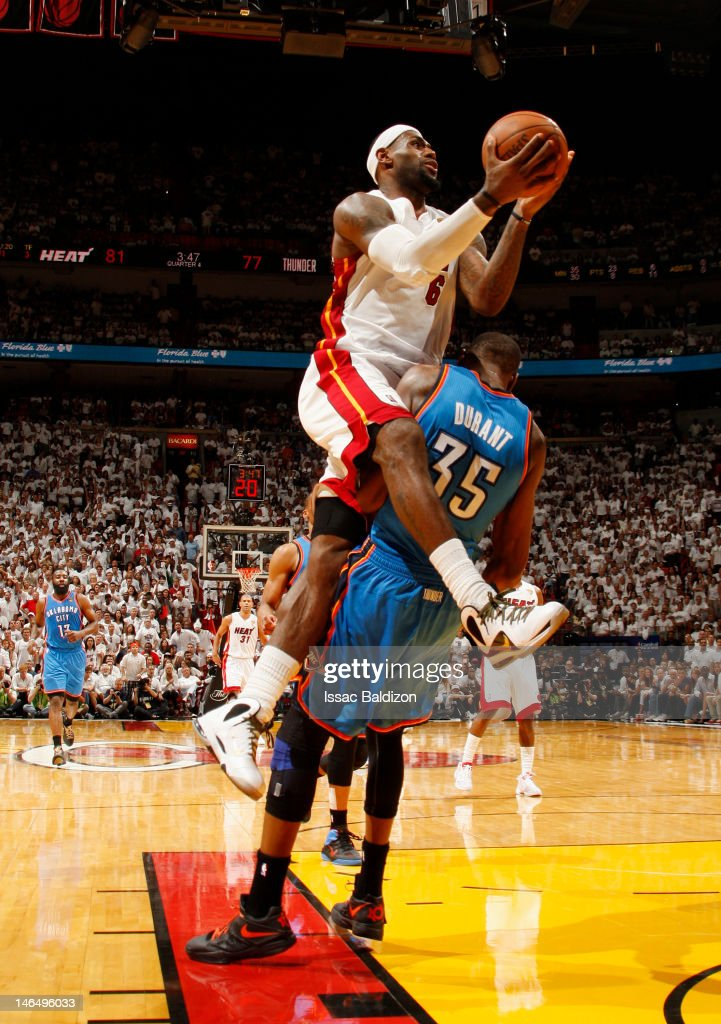 LeBron James #6 of the Miami Heat goes to the basket as Kevin Durant #35 of the Oklahoma City Thunder gets called for a blocking foul during Game Three of the 2012 NBA Finals at American Airlines Arena on June 17, 2012 in Miami, Florida.