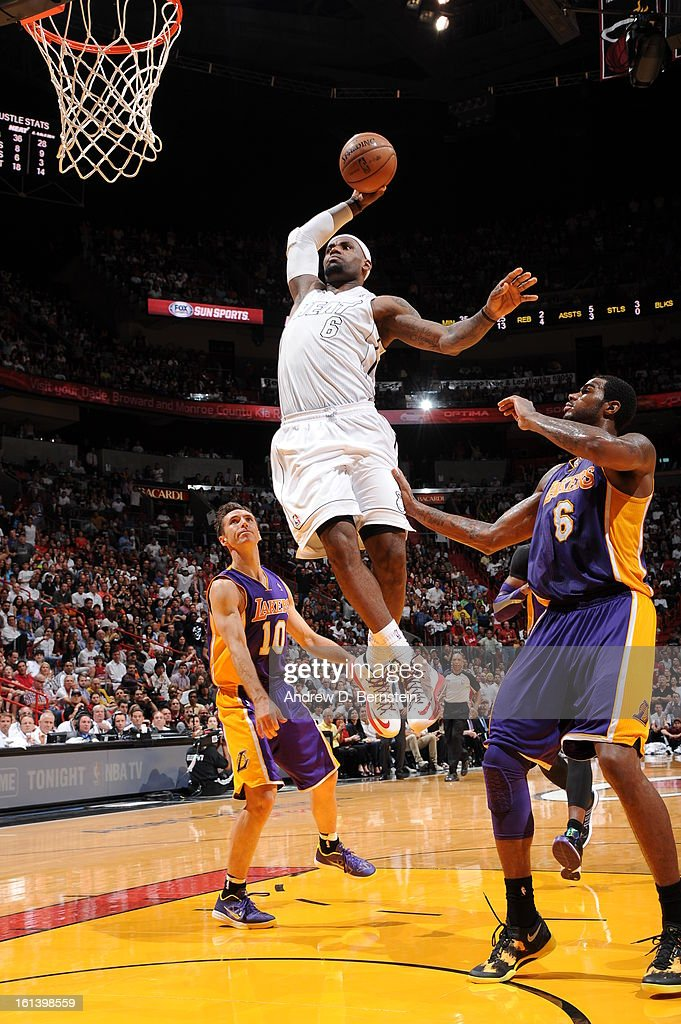 LeBron James #6 of the Miami Heat goes to the basket during a game between the Los Angeles Lakers and the Miami Heat on February 10, 2013 at American Airlines Arena in Miami, Florida.