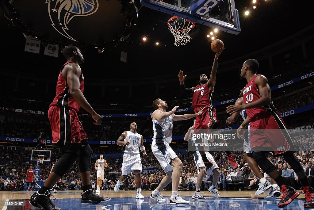 Miami heat v orlando magic lebron james 6 of the miami heat goes to the basket during the game between voltagebd Images