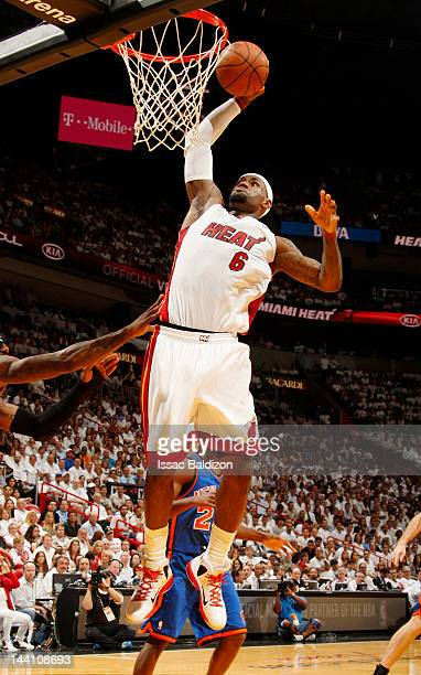 LeBron James of the Miami Heat goes to the basket for a dunk against the New York Knicks in Game Five of the Eastern Conference Quarterfinals during...